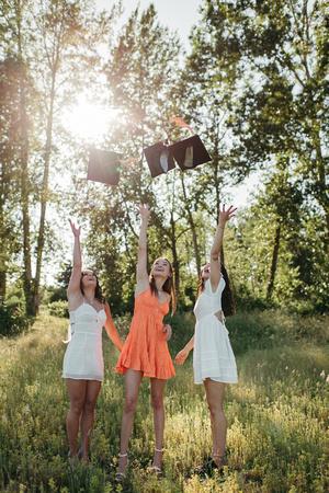 High school senior graduation cap and gown photos