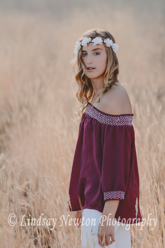 Senior girl session with flower crown in the summer, warm golden light.