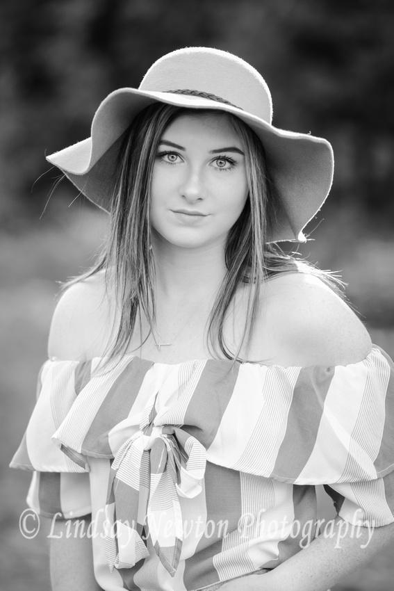 Black and white senior girl image with floppy hat