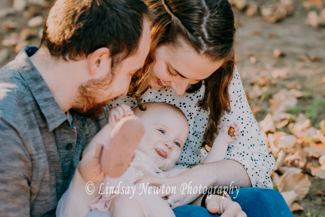 Fall family session laughing with baby at Willamette Mission Park in Keizer, Oregon.