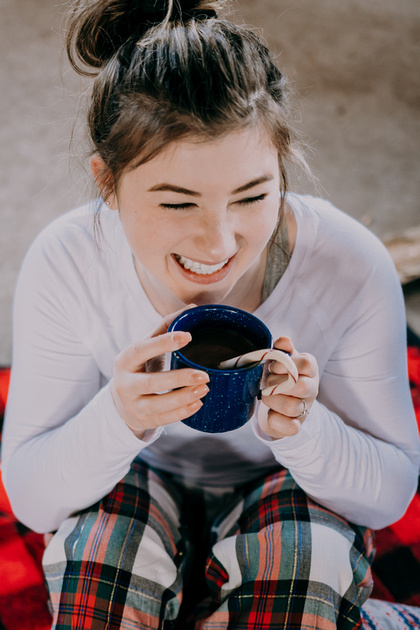 Senior girl session at a cabin in pajamas and hot cocoa