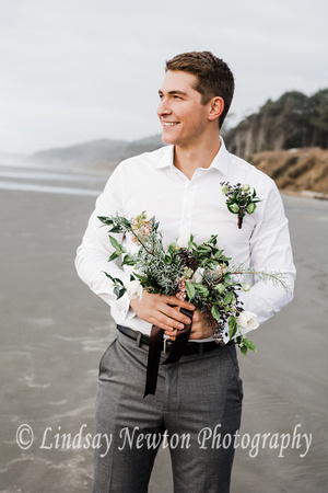 windy engagement session on Ruby beach in Washington with gorgeous florals.