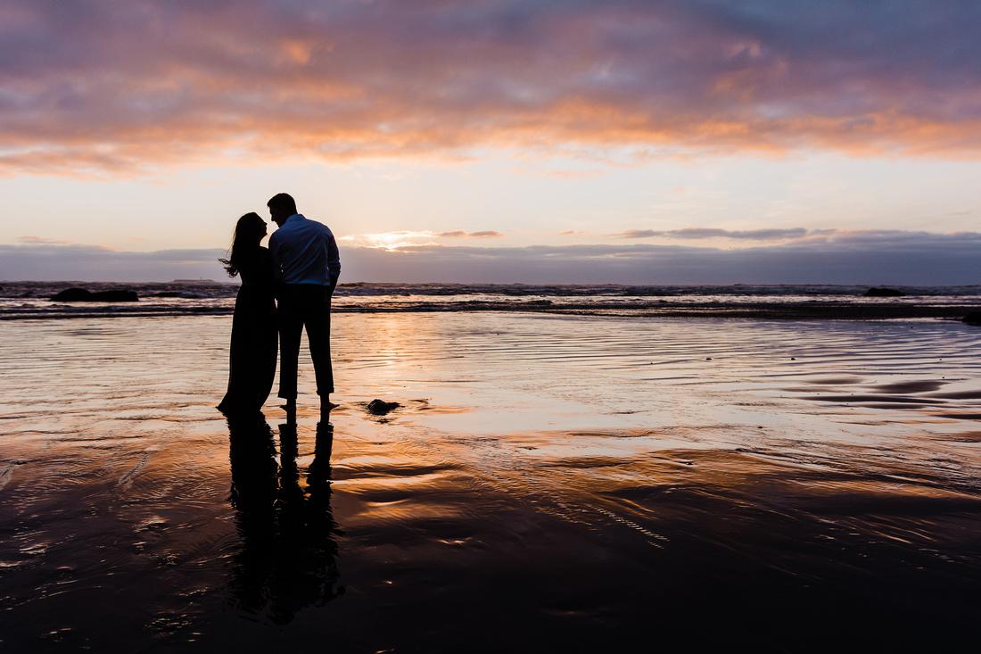 couple at sunset on the Oregon coast.