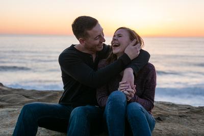 couple dancing and laughing during photo shoot at Cape Kiwanda