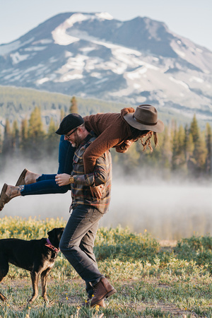 Outdoorsy couples sunrise session at Sparks Lake with their two dogs.