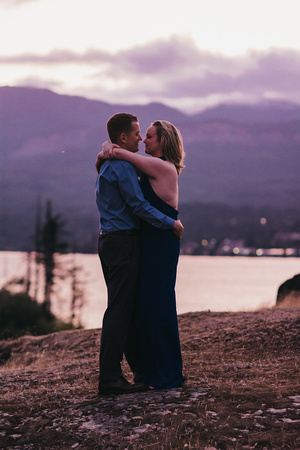 Engagement session at Government Cove, Oregon. Couple is slow dancing as the sun goes down.