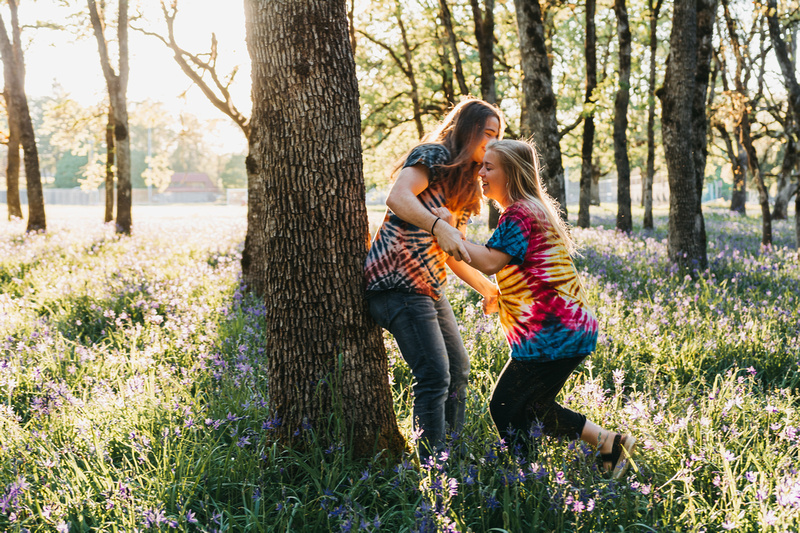 Couples photo session in a field of purple flowers