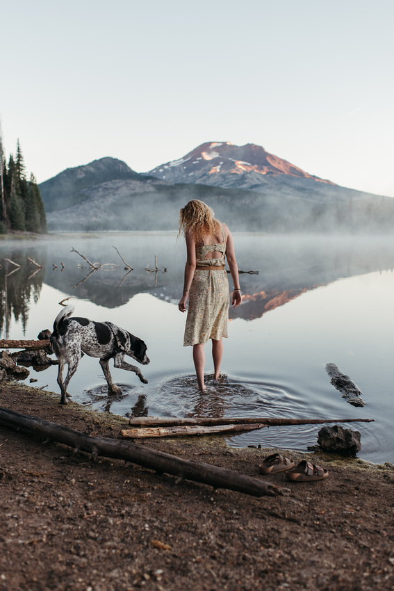 High school senior girl with her dog at a sunrise photo session at Sparks Lake, Oregon