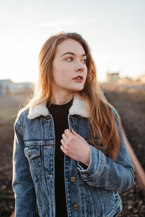 high school girl in denim jacket