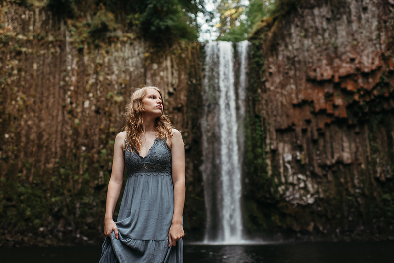 High school senior girl standing in front of a Abiqua Falls in Oregon
